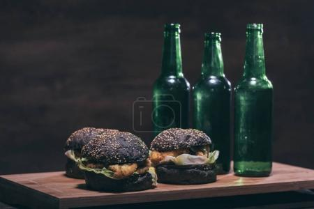 tasty burgers and bottles on kitchen desk