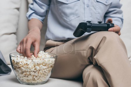woman eating popcorn at home