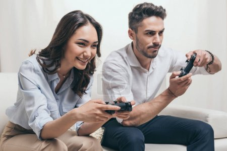 Couple playing video games at home