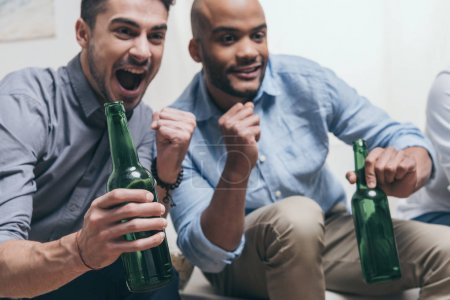 men watching football and drinking beer