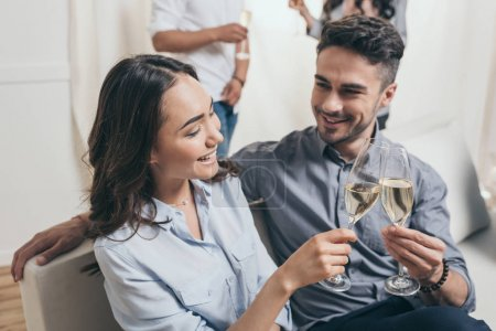 young couple clinking with champagne glasses