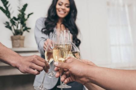 Friends clinking with champagne glasses