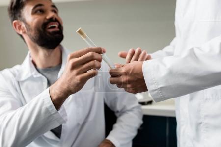 Chemists holding test tube