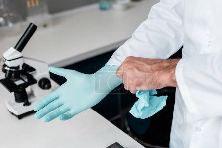 Scientist in protective glove