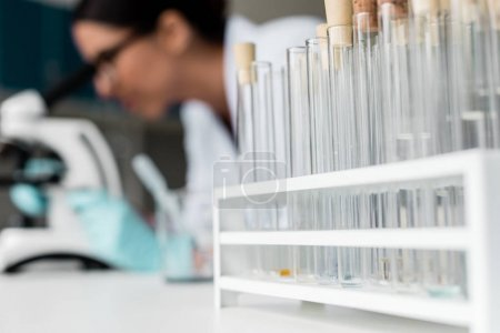 Photo for Close-up view of test tubes with reagents and samples on table in chemical lab - Royalty Free Image