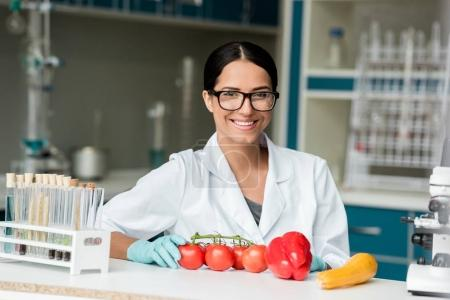 Scientist examining vegetables