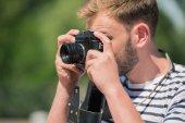 Bearded male photographer