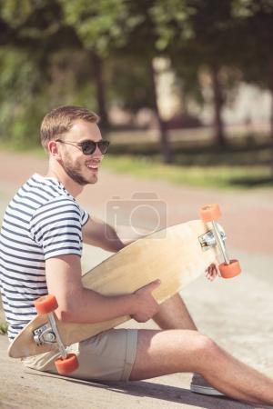 Handsome man with skateboard