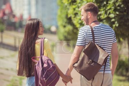 multiethnic couple walking in park