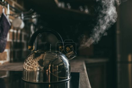 Kettle boiling on electric stove