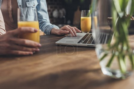 Person at table using laptop