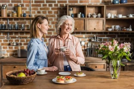 Photo for Two women, senior and young having good time in kitchen - Royalty Free Image