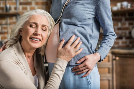 senior woman listening belly