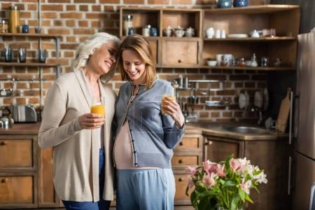 pregnant woman and her mother on kitchen