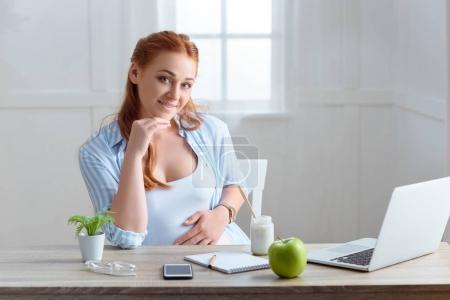 redhead pregnant woman at home