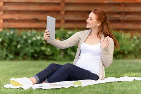 pregnant woman making video call