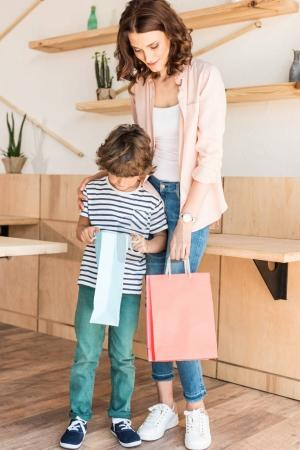 Mother and son with shopping bags