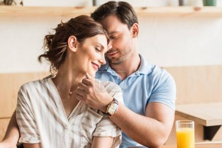 Photo for Happy young couple dating in cafe and cudling - Royalty Free Image