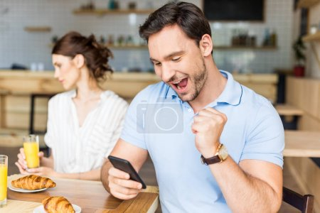unhappy couple in cafe