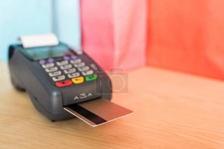 Photo for Close-up view of POS terminal with credit cards - Royalty Free Image