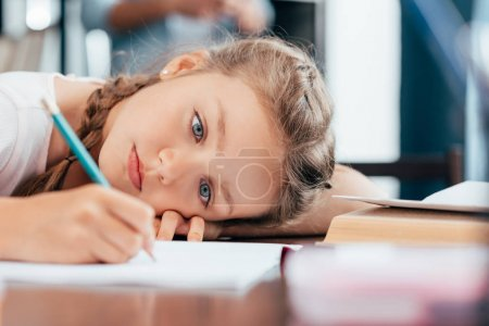 Girl writing homework