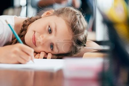 little girl writing homework