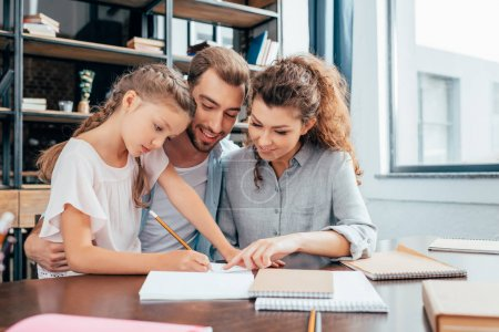 parents doing homework with daughter