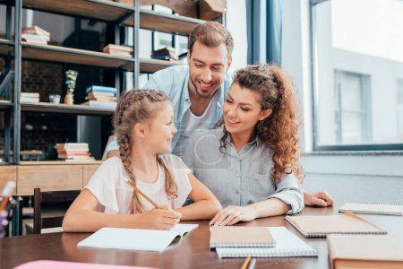 parents doing homework with daughter