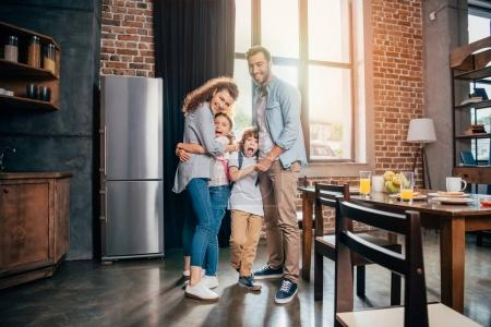 family embracing on kitchen