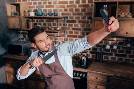man taking selfie while cooking