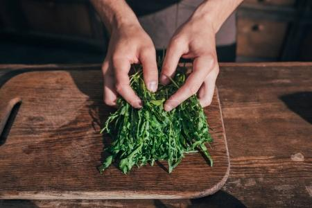 man sorting ruccola leaves