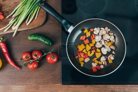 Photo for Top view of vegetables frying in pan - Royalty Free Image
