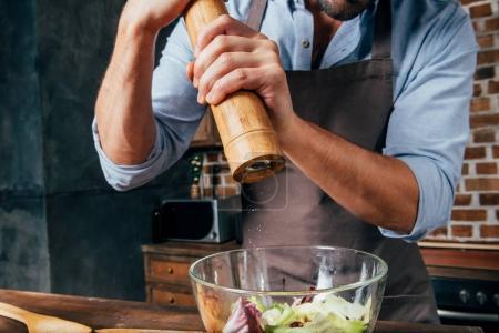 man making salad