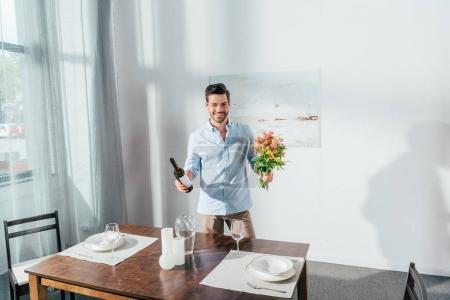 homme avec bouquet de fleurs et vin
