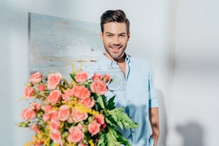 Photo for Man with beautiful bouquet looking at camera - Royalty Free Image