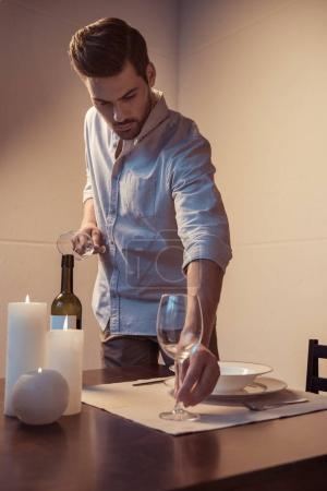 man preparing romantic dinner