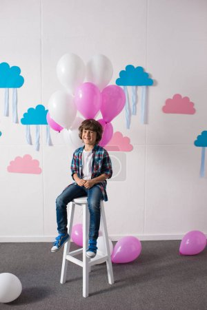 Happy little boy with balloons