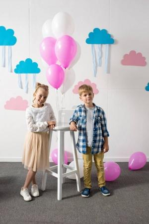kids with balloons at birthday party