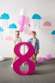 boy and girl with number eight