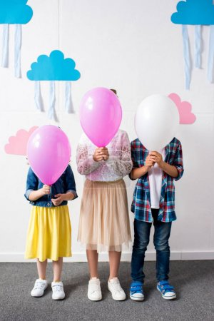 adorable kids with balloons