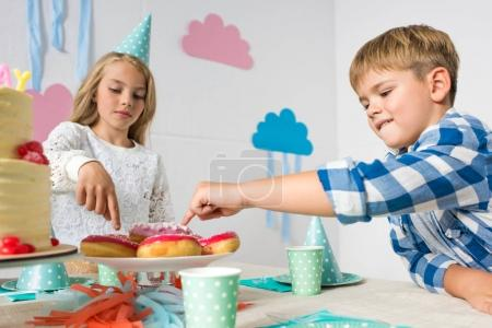 boy and girl at birthday table