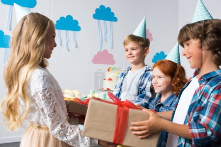 children with gifts at birthday party