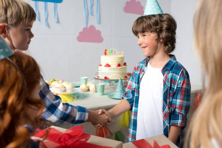 kids presenting gifts at birthday party