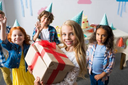 multiethnic kids with birthday presents
