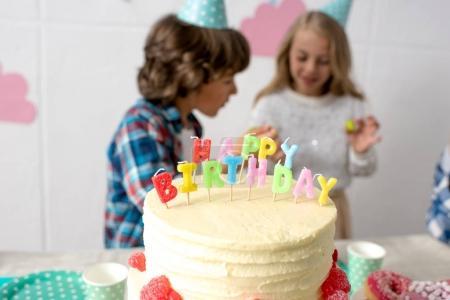 happy kids with birthday cake