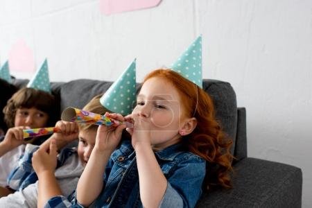 children with party blowers