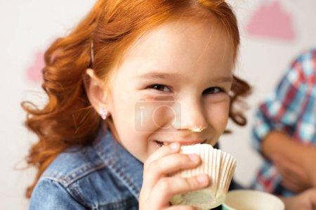 girl eating cupcake