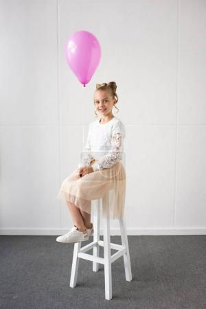 Cute little girl with balloon