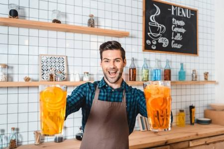 Barman with refreshing lemonades