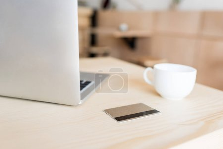 laptop, credit card and cup of coffee